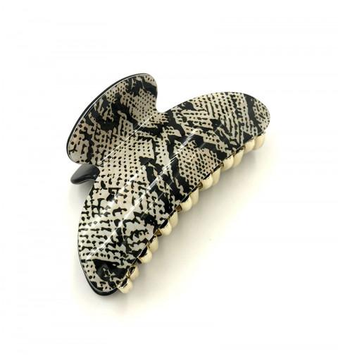 Hårklämma med ormskinn-mönster.