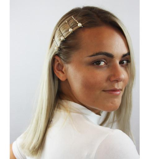 Silverfärgade hårnålar med vita pärlor